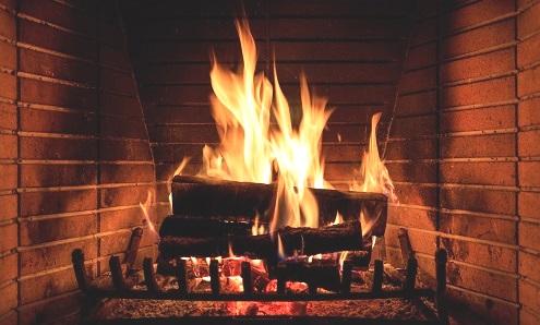 Warm Fireplace with Firewood