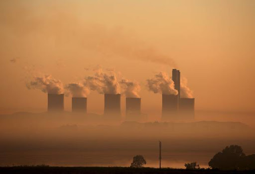 Steam rises at sunrise from the Lethabo Power Station, a coal-fired power station owned by state power utility ESKOM near Sasolburg on March 2, 2016.