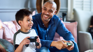 Man and young boy play a game