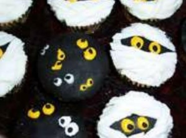 scary eyes and mummies Eyes -just attach assorted eyes two by two on black frosting. Mummies-...