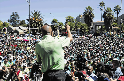 MASS APPEAL: Amcu president Joseph Mathunjwa outside Impala's Joburg offices