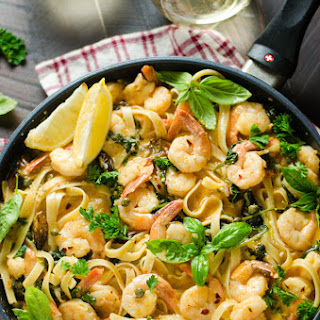 Creamy Lemon Butter Shrimp Pasta with Spinach and Caramelized Garlic.