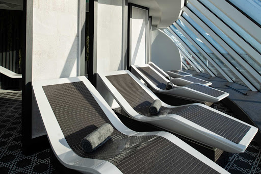 celebrity-edge-Spa-heated-tile-chairs.jpg -  Get comfy in the heated tile chairs in the Spa on Celebrity Edge, which offers the perfect way to clear your mind and reinvigorate your spirit.