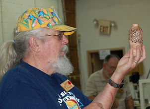 Photo: ...and he's still into piercing too, as evidenced by this turned, carved, and pierced pecan vessel.