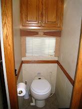 Photo: Water closet with ceramic stool.