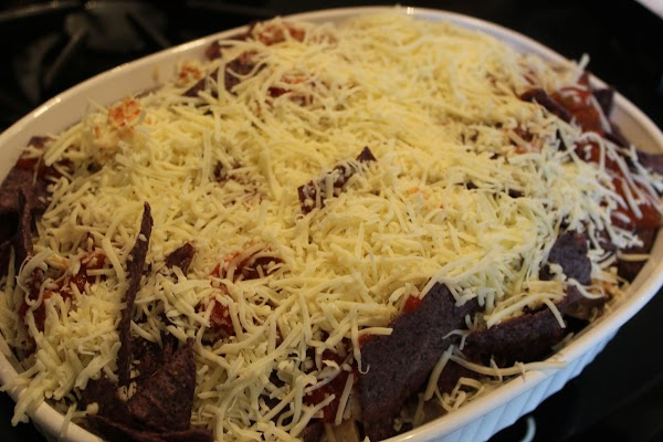 Bake nachos 15-20 minutes or until heated through and cheese melts and begins to...