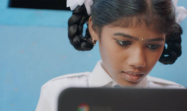 A girl using a Chromebook