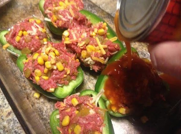 Seed and half peppers lengthwise.  Fill equally with beef mixture.  Pour the remaining...