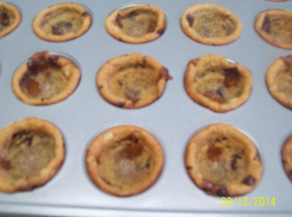 Remove Cookies from oven. press down centers to form cups. (melon baller or similar...