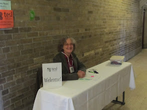 Photo: Day 1 - Joan's ready at the registration desk.