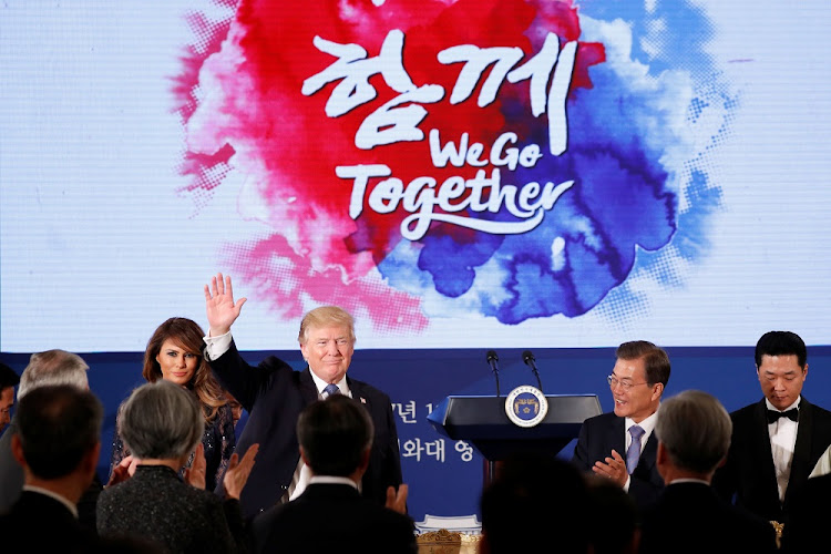 US President Donald Trump and first lady, Melania, attend a state dinner hosted by South Korean President Moon Jae-in at the Blue House in Seoul, South Korea, on November 7 2017. Picture: REUTERS