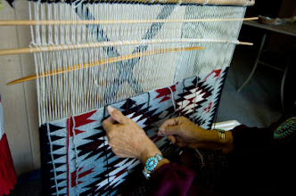 Photo: Navajo woman weaving a rug MOTION OF HANDS