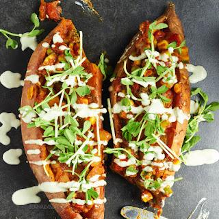 Korma Stuffed Sweet Potatoes with a Garlic Tahini Dressing Recipe