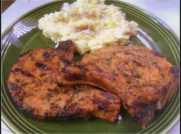 Remove chops and rinse them. Then drizzle with olive oil and pat on your...