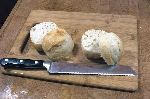 Cut the tops off the dinner rolls, and reserve.