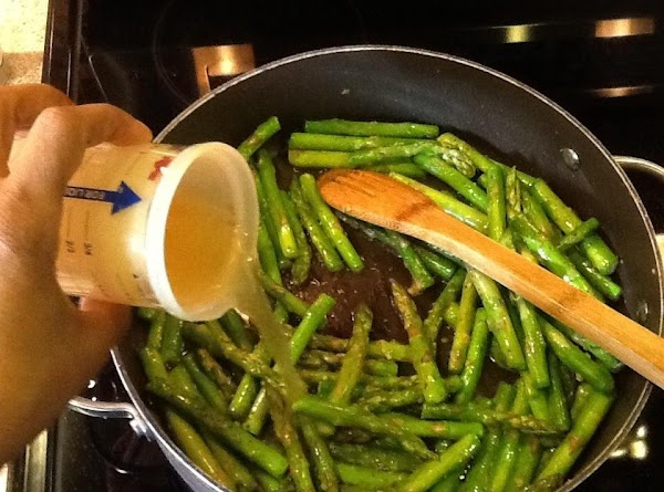 Add bouillon to water and add to pan. Let asparagus simmer over medium to...