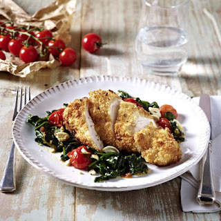 Cashew Crusted Chicken Breast over Wilted Spinach.