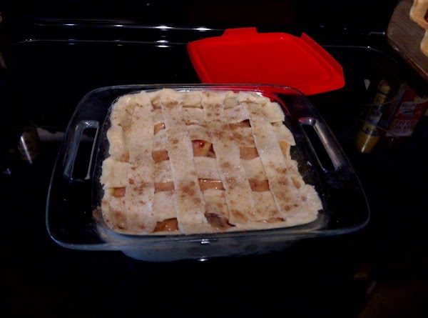 Lay 4 of the strips of crust across the pan. Then lay the last...