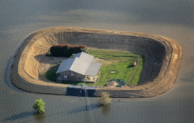 Levee protect house from floodwater