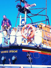 """Photo: The """"Lincolnshire Poacher"""" Skegness Lifeboat crew member watching the tow coupling as the boat is reversed back into the station."""
