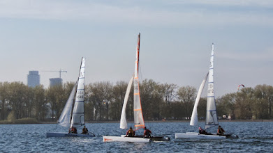 Photo: everyone's on Starboard but the orange boat is setting up tactical advantage on the inside