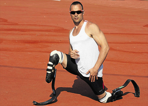 Sprinter Oscar Pistorius is confident the South African athletics team at this year's London Olympic Games will improve on the solitary medal achieved in Beijing four years ago. Pistorius is trying to become the first amputee to take part in an Olympics Picture: SYDNEY SESHIBEDI