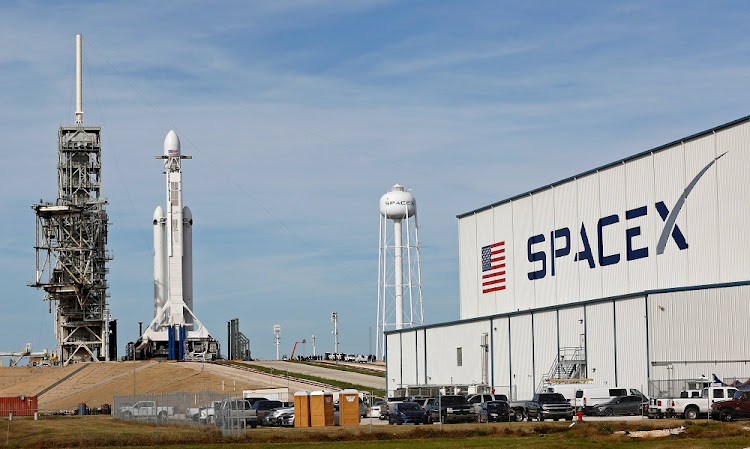 A SpaceX Falcon Heavy rocket stands on historic launch pad 39A as it is readied for its first demonstration flight at the Kennedy Space Center in Cape Canaveral, Florida, U.S., February 5, 2018.