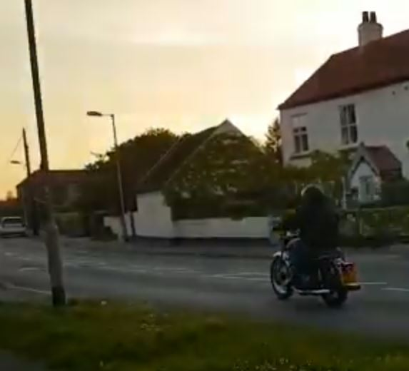 Riding off into the sunset on an imported Triumph Bonneville motorcycle.