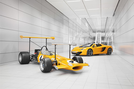 The 1969 McLaren F1 M7C is seen here alongside the 12C Spider.