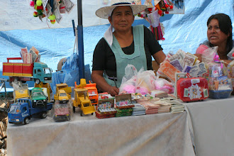 Photo: This woman is selling miniature items that represent what people want in real life. People will purchase these items, then do sacrifices to Pachamama/Mary with them, so that they will actually gain them this year.