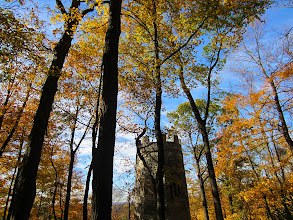Photo: Castle tower hidden in the fall forest at Hills and Dales Park in Dayton, Ohio.