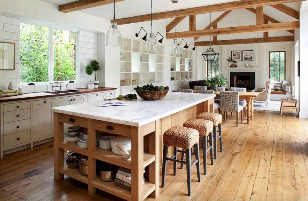 This space feels like the perfect country getaway with plenty of wood accents and upholstered bar stools.