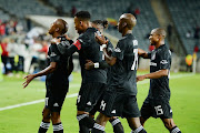 Luvuyo Memela of Orlando Pirates celebrates his goal with teammates during the Absa Premiership match between Orlando Pirates and Black Leopards at Orlando Stadium on April 10, 2019 in Johannesburg, South Africa.