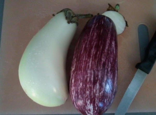 Cut top tips off of eggplants.  Peel eggplants halfway down.  Cut just...