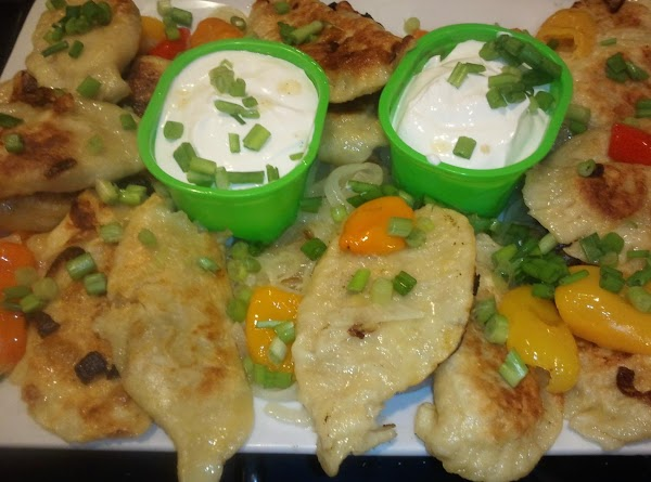 ADD PIEROGIS & LET BROWN ON EACH SIDE. rEMOVE TO LARGE PLATTER, AND TOP...