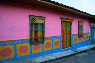 Photo: Part of what makes Guatapé special is the town's universal requirement to adorn each building with zócalos. Each zócalo design is chosen by the owner of the home and can either be artistic or actually represent something specific about that person or family. Many examples of zócalos to follow...