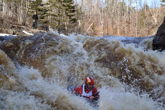 Photo: Kayaker Jonathan Sisley makes his way down one of the larger rapids on the Lester River as spectators look on. makes his way down one of the larger rapids on the Lester River as spectators look on.