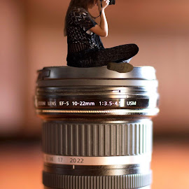 Mounted on a lens by Tamara Jacobs - Digital Art People ( lens portrait girl photographer photo abstract )