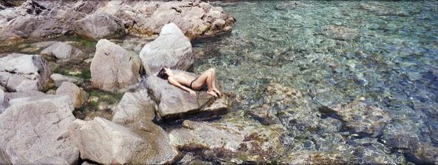 sunbathing in Ai Giorgis, Kavo Papas, Ikaria