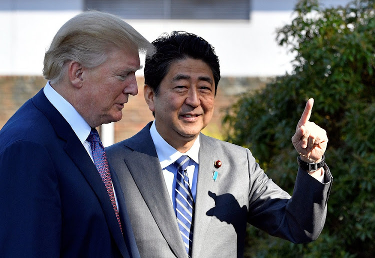 US President Donald Trump is welcomed by Japan's Prime Minister Shinzo Abe at the Kasumigaseki Country Club in Kawagoe, near Tokyo, Japan, November 5 2017. Picture: REUTERS