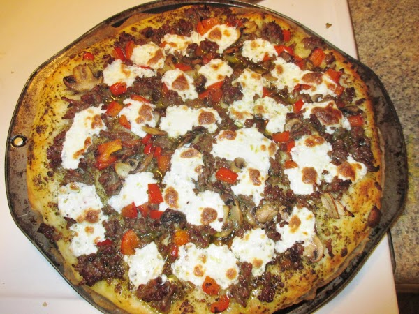 Bake the pizza for 10 minutes.  You may wish to preemptively disable any...