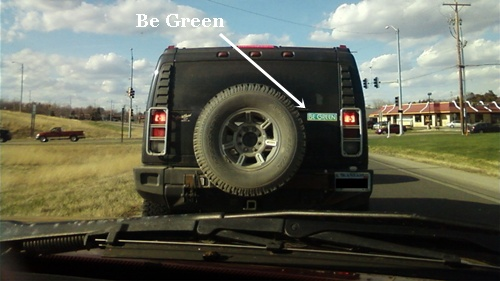 photo of a Hummer with a go green bumper sticker