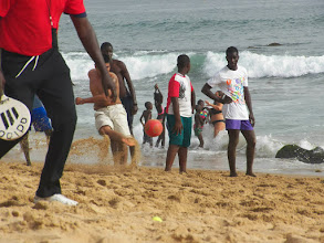 Photo: Playing soccer on the beach in Dakar.