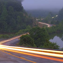 Winding Lake Road by Kevin Frick - Transportation Roads ( hills, car lights, fog, west virginia, lake, road )