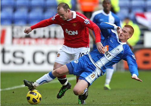 Rooney is tackled by Ben Watson, Wigan - Manchester United