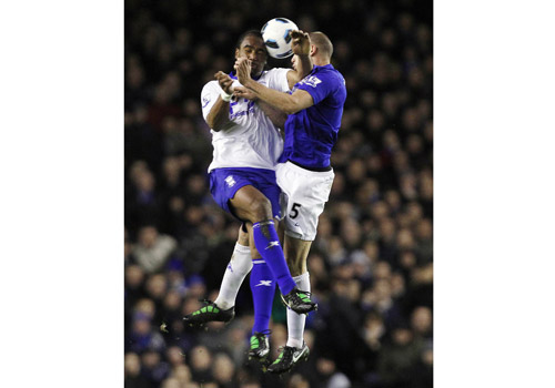 Johnny Heitinga heading with Cameron Jerome, Everton - Birmingham