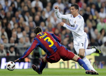 Ronaldo with Pique, Real Madrid - Barcelona