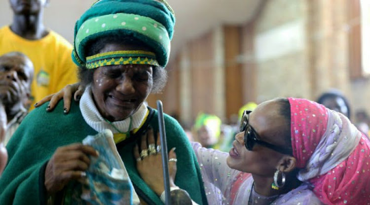 Yvonne Brown soothes Gogo Mathilda Rwendana, 81, who became upset when the crowd turned hostile towards mayor Athol Trollip.