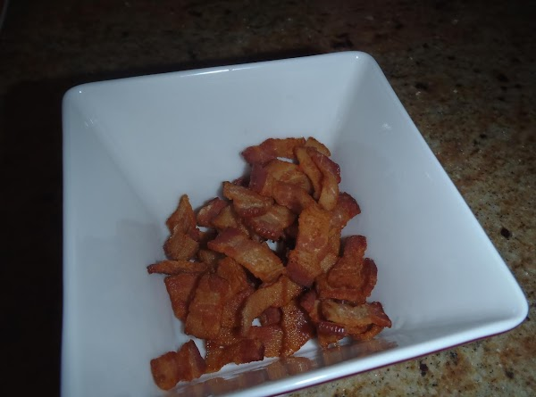 Cut bacon into lardons (small cubes).  Use a very large deep skillet pan...