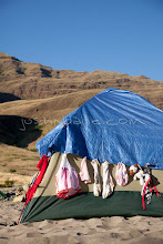 Photo: Clothes and stuffed animal drying on the side of tent while on a raft trip down Hell's Canyon of the Snake River, ID / OR. Hell's Canyon is the deepest canyon in North America.